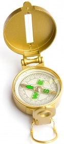 Photograph of gold compass with lid open